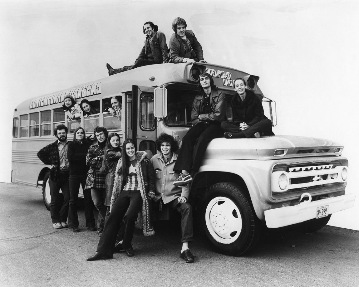 WCD Tour Bus, 1971 In photo: (in the windows, L-R) Elaine Loo, Michele Presley, Holly Anne Savage; (Standing, L-R) 2 crew members, David Tucker, Barbara Johnson, Janet Oxley, Jim Green; (on roof L-R) David Weller, Charlie Moulton; (on hood, L-R) Larry Brinker, Rachel Browne Photographer: Unknown